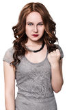 Young angry woman shows threaten fist. Young angry woman shows threaten fist on the white background stock photography