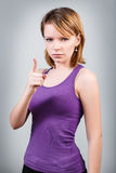 Young angry woman threaten finger. On the gray background stock photo