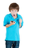 Young annoyed screaming kid on mobile phone Royalty Free Stock Photography