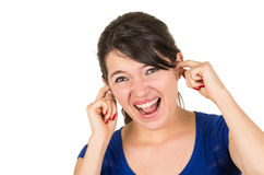 Young annoyed unhappy girl covering ears Royalty Free Stock Photography