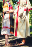 Young anonymous couple in folklore costumes Stock Image