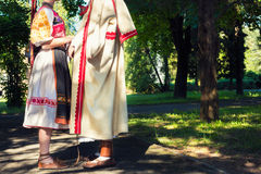 Young anonymous couple in folklore costumes Royalty Free Stock Photos