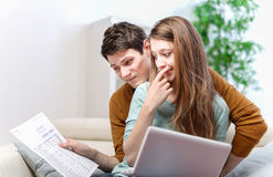 Young anxious couple consults their bank account Stock Images