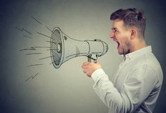 Screaming man with painted loudspeaker stock photos
