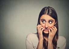 Free Young Anxious Unsure Hesitant Nervous Woman Biting Her Fingernails Stock Photo - 57640970