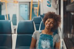 Black girl in metro train alone royalty free stock images