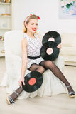 Young appealing woman demonstrating vinyl records. Stock Photo