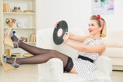 Young appealing woman with vinyl record. Royalty Free Stock Photo