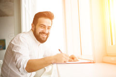 Young applicant filling application form Stock Image