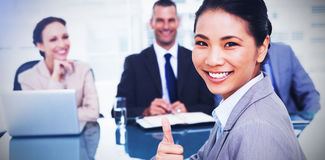 Young applicant giving thumb up after obtaining the job Royalty Free Stock Image