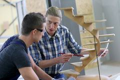 Young apprentice with carpentry instructor Royalty Free Stock Image