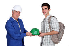 Young apprentice and mature workmate Royalty Free Stock Photography