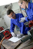 Young apprentice in plumbery working royalty free stock image