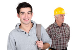 Young apprentice posing next to craftsman Royalty Free Stock Photo