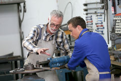 Young apprentice in professional training in ironworks Stock Photo