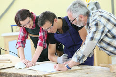 Young apprentices in carpentry training Stock Photography
