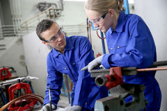 Young apprentices in plumbery training Stock Photo