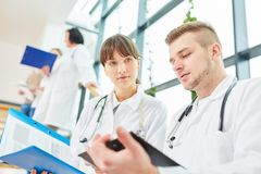Young apprenticeship doctors. In teamwork with cooperation royalty free stock photos