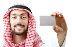 Young arab with blank message. On the white background Stock Images