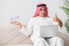 The young arab businessman in business concept Stock Images