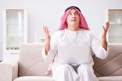 The young arab businessman working with laptop on sofa Royalty Free Stock Photography