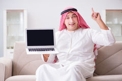 The young arab businessman working with laptop on sofa Stock Image