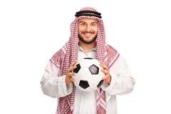 Young Arab holding a football Stock Photos