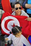 Young arab lady with red flag and  little girl Royalty Free Stock Photos