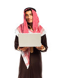 Young arab with laptop isolated on white background Royalty Free Stock Photography
