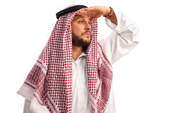 Young Arab looking in the distance Stock Photography