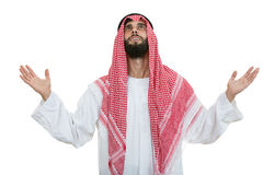 Young arab man of muslim religion praying isolated on white background Royalty Free Stock Image