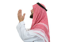 Young arab man of muslim religion praying isolated on white background Stock Photography