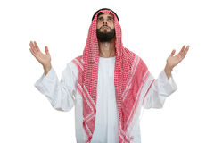 Young arab man of muslim religion praying isolated on white background Royalty Free Stock Photo