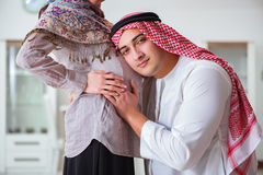 The young arab muslim family with pregnant wife expecting baby Royalty Free Stock Photos