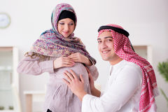 The young arab muslim family with pregnant wife expecting baby Royalty Free Stock Photography