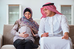 The young arab muslim family with pregnant wife expecting baby Stock Photography