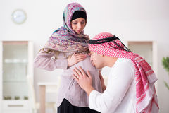The young arab muslim family with pregnant wife expecting baby Stock Photo
