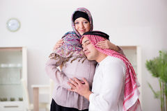 The young arab muslim family with pregnant wife expecting baby Stock Images