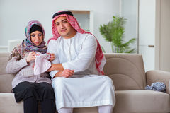 The young arab muslim family with pregnant wife expecting baby Royalty Free Stock Images