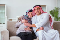 The young arab muslim family with pregnant wife expecting baby Royalty Free Stock Image
