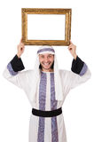 Young arab with picture frame Royalty Free Stock Photos