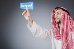 Young arab pressing   buttons Royalty Free Stock Image