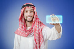 Young arab pressing virtual buttons Stock Image