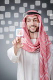Young arab pressing virtual buttons Stock Photo