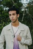 Young Arab Teen Model Posing in Nature at the Park. Attractive Middle Eastern Male Model Posing and Smiling for the Camera Outside Royalty Free Stock Image
