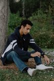 Young Arab Teen Model Posing in Nature at the Park. Attractive Middle Eastern Male Model Posing and Smiling for the Camera Outside Royalty Free Stock Photography