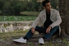 Young Arab Teen Model Posing in Nature at the Park. Attractive Middle Eastern Male Model Posing and Smiling for the Camera Outside Royalty Free Stock Photos
