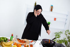 Young Arab woman cooking Royalty Free Stock Photography