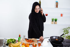 Young Arab woman cooking Stock Photo