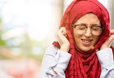 Young arabian woman wearing hijab isolated over natural background royalty free stock photos